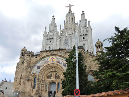 BARCELONA, SPAIN - AUGUST 14, 2013: entrance in Expiatory Church of the Sacred Heart of Jesus, Barcelona, Spain. The building is the work of the Spanish Catalan architect Enric Sagnier.