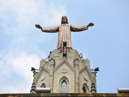 BARCELONA, SPAIN - AUGUST 14, 2013: Statue Jesus on Expiatory Church of the Sacred Heart of Jesus, Barcelona, Spain. The building is the work of the Spanish Catalan architect Enric Sagnier.