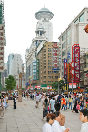 SHANGHAI, CHINA - JUNE 3, 2007: many people on Nanking Road (Nanjing Road) - main shopping street of Shanghai, China. This street is Shanghais busiest, most westernized shopping street. Editorial