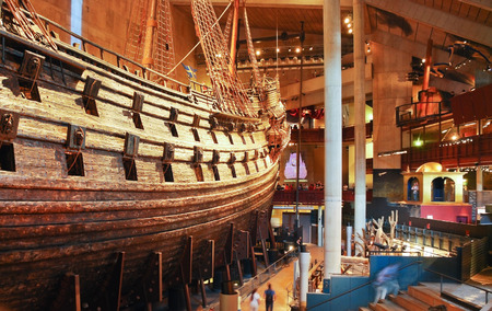 warship: STOCKHOLM, SWEDEN - AUGUST 10, 2009: interior of main hall of Vasa museum. Museum displays the only almost fully intact 17th century 64-gun warship Vasa Editorial