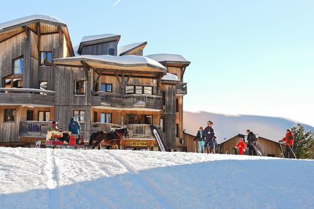 soleil: AVORIAZ, FRANCE - JANUARY 3, 2013: ski children school in Avoriaz town in Alps, Portes du Soleil. Les Portes du Soleil is major ski area in Alps, thirteen resorts between Mont Blanc and Lake Geneva Editorial