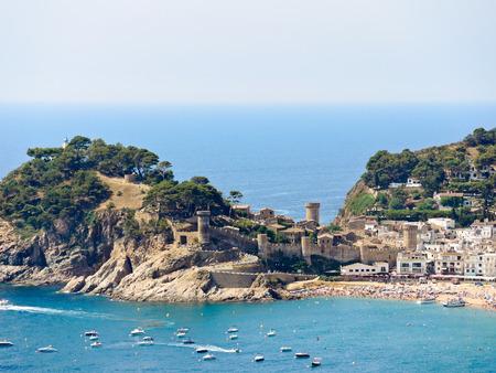 view of urban beach and Vila Vella monument in town Tossa de Mar, Costa Brava, Catalonia, Spain