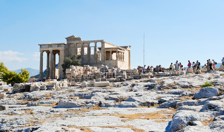 caryatids: many tourists on historic Acropolis hill near Porch of the Caryatids, Athens, Greece Stock Photo