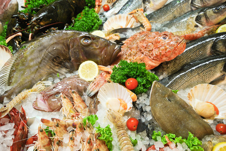 raw fresh fish and seafood on street market in Italy photo