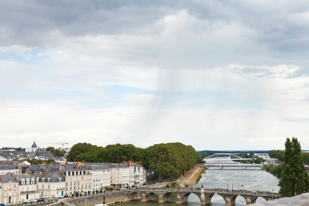 ANGERS, FRANCE - JULY 28, 2014: rain over bridges Pont de Verdun and Pont de Haute Chaine on La Maine river in Anges, France. Angers is city is the historical capital of the province of Anjou