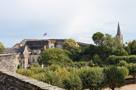 monument valley view: ANGERS, FRANCE - JULY 28, 2014: decorative gardens in Angers Castle, France. Chateau dAngers was founded in the 9th century by Counts of Anjou, was expanded to current size in 13th century