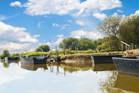 parc naturel: wooden boats near gangways in village de Breca, in Briere Regional Natural Park, France Stock Photo