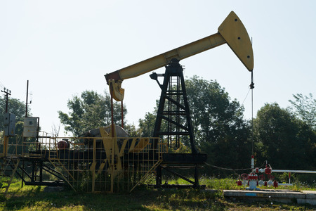 oil well pumper: pumpjack pumps oil in the foothills of the Caucasus mountain Stock Photo
