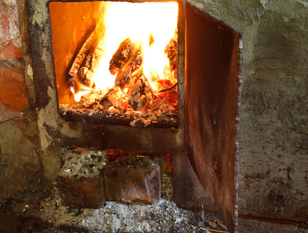 firebox: flame of burning wood in furnace with open door