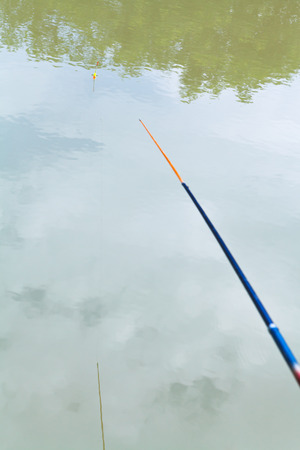 kuban: float floating in the calm river while fishing, Kuban, Russia Stock Photo