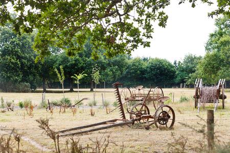 winnower: peasant household with abandoned farm equipment in village de Breca, Briere Regional Natural Park, France