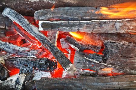 woodburning: flame over burning wood-burning coals close up Stock Photo
