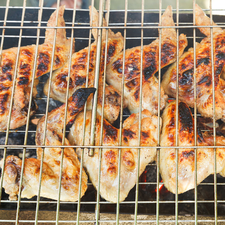brazier: grilled chicken wings on brazier close up Stock Photo