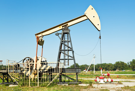 oil extraction by pumpjack in Caucasus region in summer day photo