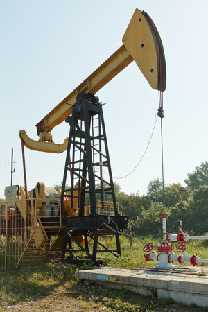 beam pump: pumpjack pumps oil in foothills of Caucasus mountain Stock Photo