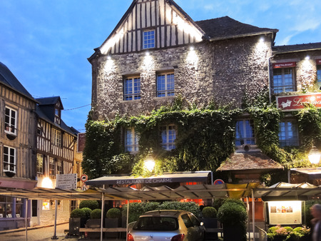 lea: HONFLEUR, FRANCE - AUGUST 4, 2014: historical edifice Les maisons de Lea in Honfleur town, France. It is made up of an old salt warehouse and three 16thC houses, and sits in the Place Sainte Catherine