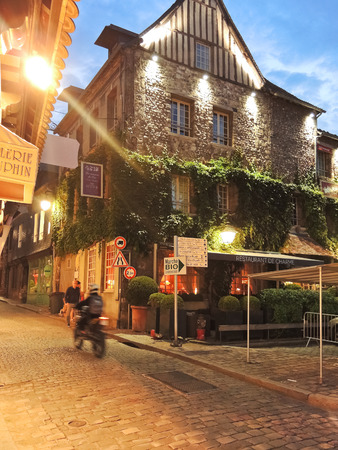 lea: HONFLEUR, FRANCE - AUGUST 4, 2014: historical building of Les maisons de Lea in Honfleur, France. It is made up of an old salt warehouse and three 16thC houses, and sits in the Place Sainte Catherine