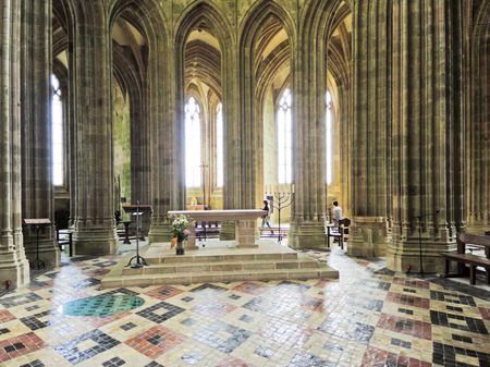 castle: MONT SAINT-MICHEL, FRANCE - AUGUST 9, 2014: Interior of Church-abbey Mont Saint Michel. The abbey has been protected as a French monument historique from 1862