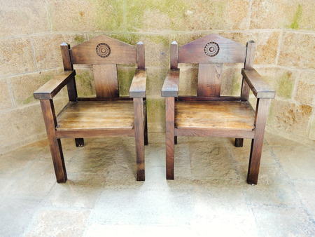 mount saint michael: MONT SAINT-MICHEL, FRANCE - AUGUST 9, 2014: wooden armchairs in church-abbey of Mont Saint Michel. The abbey has been protected as a French monument historique from 1862