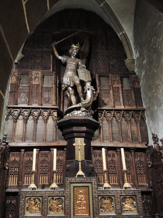mount saint michael: MONT SAINT-MICHEL, FRANCE - AUGUST 9, 2014: silver St Michael statue in Eglise St Pierre of abbey Mont Saint Michel. The abbey has been protected as a French monument historique from 1862
