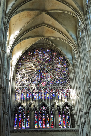 AMIENS, FRANCE - AUGUST 10, 2014: stained glass window of Amiens Cathedral. The Cathedral Basilica of Our Lady of Amiens was built between 1220-1270 and has been listed as UNESCO World Heritage Site