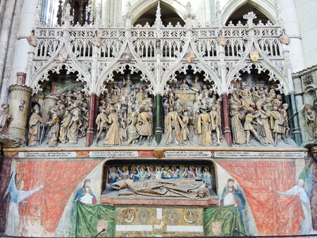 AMIENS, FRANCE - AUGUST 10, 2014: decorated tomb in Amiens Cathedral, France. The Cathedral Basilica of Our Lady of Amiens was built between 1220-1270 and has been listed as UNESCO World Heritage Site