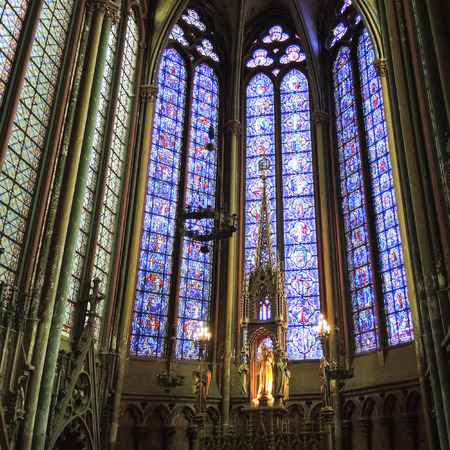 AMIENS, FRANCE - AUGUST 10, 2014: wall and stained glass window of Amiens Cathedral. The Cathedral Basilica of Amiens was built between 1220-1270 and has been listed as UNESCO World Heritage Site Editorial