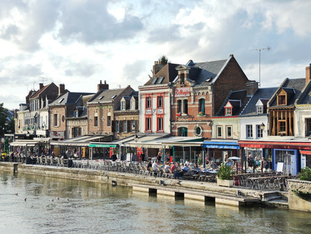 leu: AMIENS, FRANCE - AUGUST 10, 2014: restaurants on Quai Belu on Somme river in Amiens city, France. Amiens is the capital of the Somme department in Picardy, France. Editorial