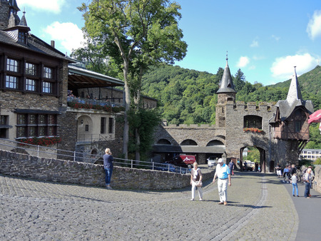mention: COCHEM, GERMANY - AUGUST 12, 2014: tourists in Cochem Imperial castle (Reichsburg Cochem) in Germany. The Reichsburg Cochem had its first documentary mention in 1130.