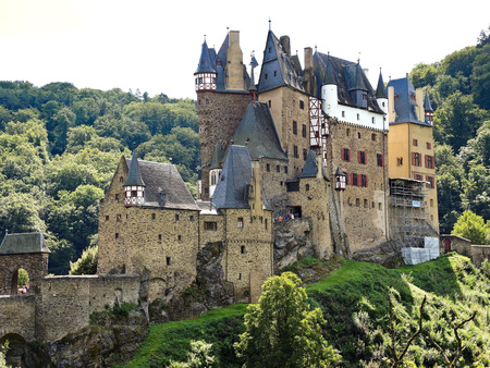 family owned: BURG ELTZ, GERMANY - AUGUST 12, 2014: view of Castle Eltz above Mosel river, Germany. The castle is still owned by a branch of same family that lived there in the 12th century, 33 generations ago Editorial
