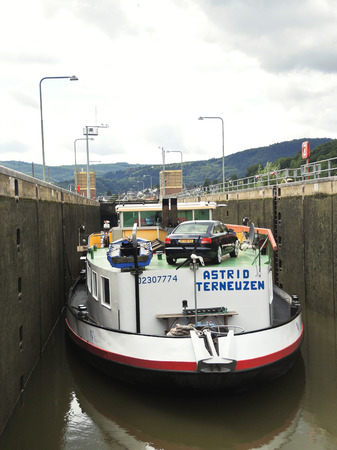 sluice: KOBLENZ, GERMANY - AUGUST 14, 2014: barge in Lehmen sluice on Moselle river. The sluice was built in 1961, lenght is 175,4 m, widht 12m.