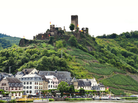 mentioned: BEILSTEIN, GERMANY - AUGUST 14, 2014: view of Beilstein village and Metternich Castle (Burg Beilstein) on Moselle river, Germany. Castle Metternich it was first mentioned in 1268, destroyed in 1689.