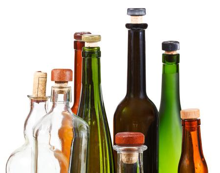 whiskey bottle: many empty closed wine bottles isolated on white background
