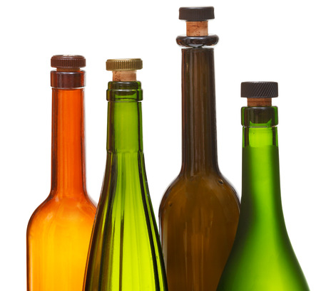 amber coloured: few empty closed wine bottles close up isolated on white background