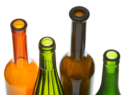 bottlenecks: four open bottlenecks of colored wine bottles close up isolated on white background