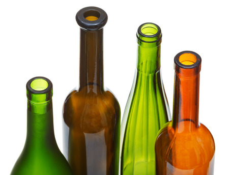 bottlenecks: four open bottlenecks of colored wine bottles isolated on white background