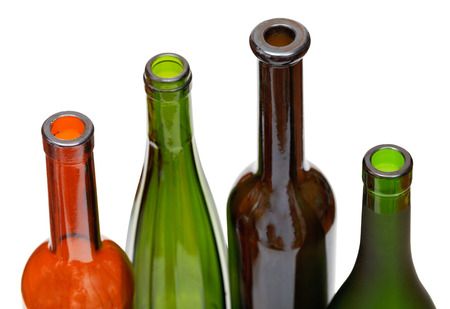 bottlenecks: bottlenecks of few colored wine bottles close up isolated on white background