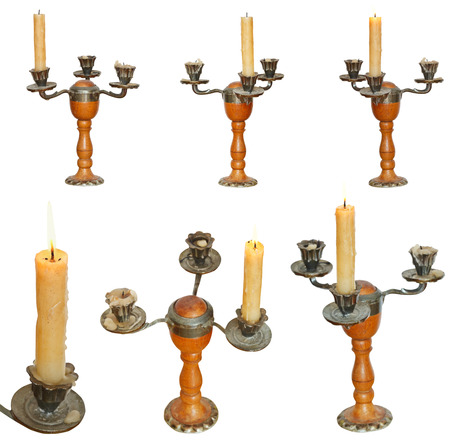 set of candleholder with candles isolated on white background photo