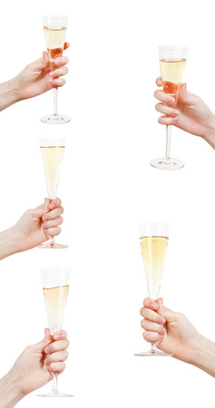set of hand raises glass with champagne isolated on white background photo