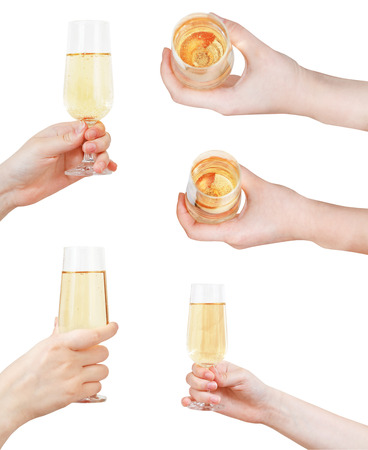 set of hand holding glass with sparkling wine isolated on white background photo