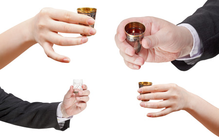 proposing a toast: set of hands with glass of spirits isolated on white background