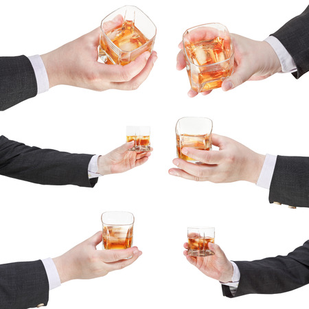 proposing a toast: set of of whiskey with ice glass in businessman hand isolated on white background