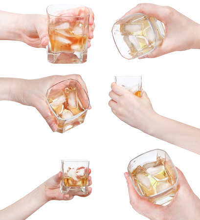 front raise: set of hand holds whiskey on ice in glass isolated on white background