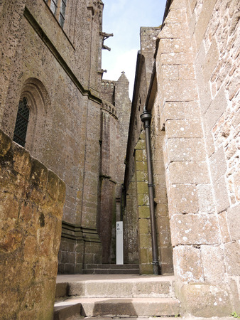 mount saint michael: in courtyard of abbey mont saint-michel in Normandy, France