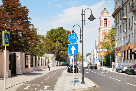 cycleway: MOSCOW, RUSSIA - SEPTEMBER 13, 2014: new bikeway on Pyatnitskaya street in Moscow after reconstruction. New pedestrian area on this old street was opened august 22, 2014