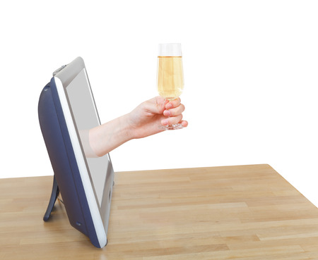 leans on hand: hand holds wineglass with sparkling wine leans out TV screen isolated on white background