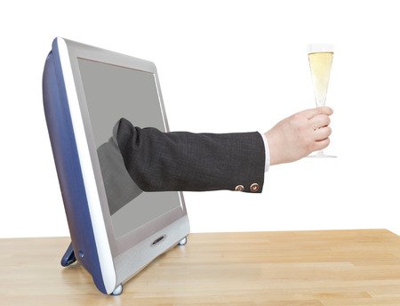 leans on hand: champagne glass in businessman hand leans out TV screen isolated on white background Stock Photo