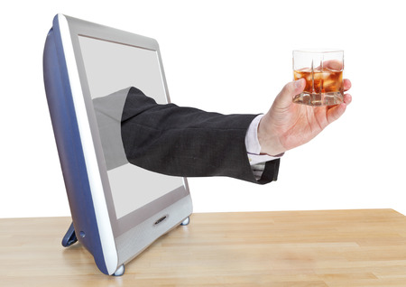 leans on hand: whisky with ice glass in businessman hand leans out TV screen isolated on white background