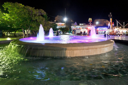 crimean: YALTA, RUSSIA - OCTOBER 2, 2014: fountain on seafront of Yalta city in night, Crimea. Yalta is resort city on the north coast of the Black Sea on the Crimean peninsula.