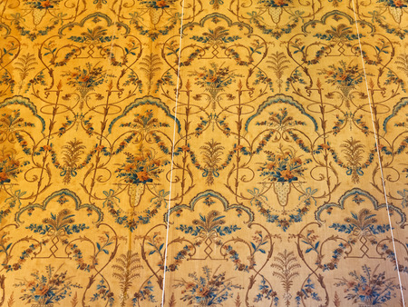 vorontsov: ALUPKA, RUSSIA - SEPTEMBER 28, 2014: old chintz wallpaper in room of Vorontsov (Alupka) Palace in Crimea. The palace was built between 1828 and 1848 for Prince Vorontsov for use as summer residence Editorial